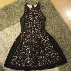 "NWT Black & Tan Lace Sleeveless Dress New with tags. Beautiful black lace design with tan slip. Waist is 14"" below collar, as shown in pics. Full length is 32"". Zipper back closure.   Body: 71% Nylon/29% Cotton Upper Side Panels: 95% Polyester/5% Spandex Lining: 100% Polyester Mossimo Supply Co Dresses"