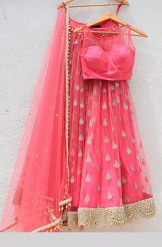 Shop pink with blest embroidery work lehenga choli online.This set is features a pink blouse in net silk.It has matching pink lehenga in net with beautiful embroidery all over and pink dupatta in net with lace. We ship worldwide to Yemen, New Zealand, Tun Plain Lehenga, Gold Lehenga, Net Lehenga, Lehenga Choli Online, Brocade Lehenga, Lengha Choli, Anarkali, Indian Dresses, Indian Outfits