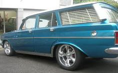 Beautiful blue station wagon with shutter blinds