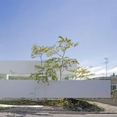 Floating fence surrounds house and  doll-making atelier by UID Architects
