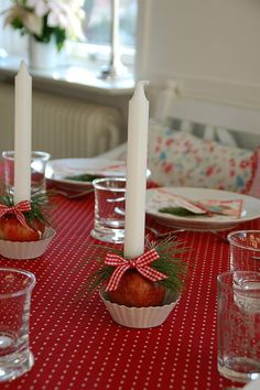 I think the red tablecloth really sets off  this white candle decoration.