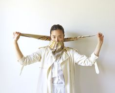New Yorker by way of Paris, Aï Bihr shows us just how many ways you can tie a scarf this summer à la Française.
