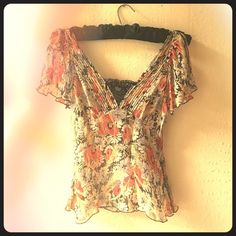 FREE PEOPLE 100% silk floral split sleeve top FREE PEOPLE 100% silk floral split sleeve top. So 20s! Feminine Sheer gauzy silk, light and airy with a Gatsby look. Side zip for form fit. Pintuck accents at neckline and across back, split flutter sleeve with peekaboo split shoulder, modesty lace at front. Easy Work-to-cocktail piece: with cute heels, just switch out a skirt for some jeans and voila! See through, so you'll want some kind of under piece, or go grunge layered over a long sleeve…