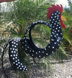 rooster of of old tires