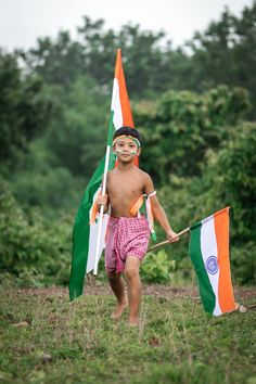 Kid Holding Two Indian Flags · Free Stock Photo