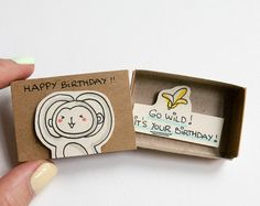 """This listing is for one matchbox. This is a great alternative to a Birthday card. Surprise your loved ones with a cute private message hidden in these beautifully decorated matchboxes! Each item is hand made from a real matchbox. The designs are hand drawn, printed on paper and then hand assembled to give each individual matchbox that special personalized touch. Weve found that these matchboxes are the perfect way to brighten someones day :) Dimensions: 2 1/16 (length) x 1 3/8"""" (w..."""