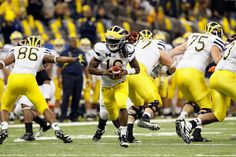 san francisco 06a65 91417 Denard Robinson in Allstate Sugar Bowl - Michigan v Virginia Tech