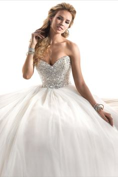 Maggie Sottero Wedding Dresses  Photos on Wedding Wire Esme a fairytale ballgown with fully encrusted bodice, this glamorous tulle dress sparkles with Swarovski crystals. Finished with a strapless sweetheart neckline, and a zipper over inner corset back closure.