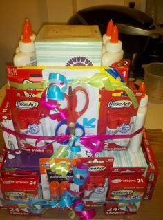 End of the year gift I made for Carter's kindergarten teacher :)   6 bottles of elmers glue, 12 glue sticks, 5 boxes of kleenex, 4 kids scissors, 12 boxes of crayons, 2 boxes of colored pencils and a gift card to starbucks :)