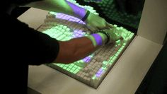 The Tangible Media Group programs a physical interface to act like sand, rubber, water, and more.