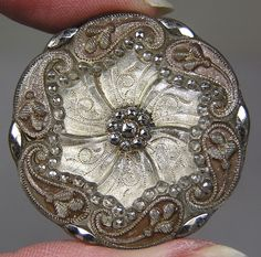 Lacy Glass Button Floral Design would look great for flower arrangements.  Maybe some old vintage buttons of Great Grandma's or a family member sentimental . . .