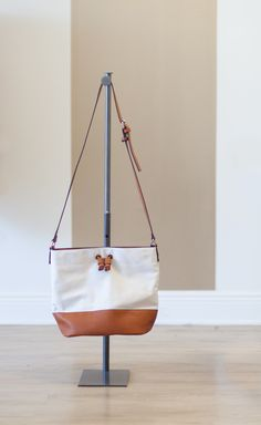 Perfect canvas and leather bucket bag combo.  Adjustable strap.