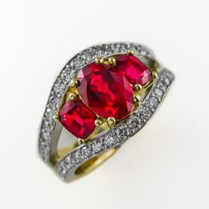 This spectacular red spinel and diamond ring has been handcrafted in our Claremont workshop in yellow and white gold. It features one central oval cut red spinel 2 cushion cut red spinels totalling and 38 pave set diamonds totalling F-VS Stone Earrings, Stone Bracelet, Stone Necklace, Stone Jewelry, Coloured Stone Rings, Red Spinel, Cushion Cut, Handcrafted Jewelry, Minerals