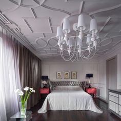 The contrast between the downstairs bedrooms and the upstairs 'male space' is almost shocking. Here, a carved ceiling acts as a canopy for a soft and luxurious bed.