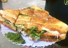 The Bombay Grilled Cheese Sandwich: Bread cheese (yes were talking good old Amul) chopped up vegetables and chilli chutney with some green coriander come together and present themselves slathered in butter in scrumptious bite-sized pieces. Take one crunchy bite and youre guaranteed to feel like everythings falling into its right place!    Recommended: Warden Road Breach Candy and Lucky Sandwich Vile Parle!  #ruchyum #ruchyumrest #foodie #grilledcheese #bombaysandwich #mumbaistreetfood…