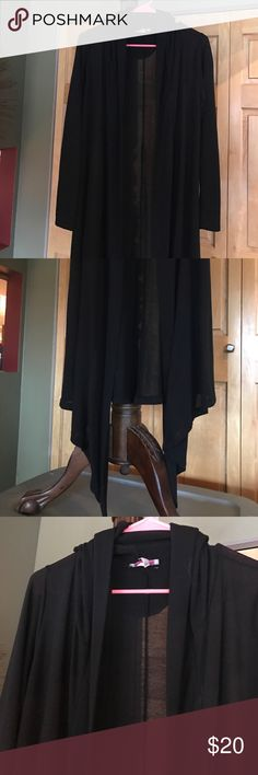 Long Black Tunic This is for you tall girls!! Very long slightly sheer hooded open front Tunic. Longer tails in front. Excellent condition. Cute over boots and leggings. Also would be cute over sleeveless dress for evening. pretty young thing Tops Tunics