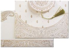 www.regalcards.com for these fascinating paisley themed invites. Beautiful designs in raised gold will leave one and all spellbound. #regalcards #elegantweddingcards #elegantinviatationcards #designerweddingcards #indianweddingcards #muslimweddinginvites #punjabimarriagecards #interfaithweddingcards #invitesfromindia #discountedinvitationcards