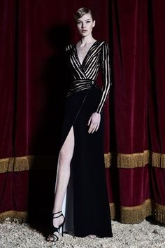 Pre F/W 2015: This is a long sleeve dress with a zebra print top piece with a deep V- neck and a black skirt with a slit. It is a sexy, fierce outfit! I would love to see this dress on the red carpet.