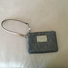 MK wristlet. NWOT Pretty Michael Kors wristlet with 2 pockets inside. Got as a gift and never used! Michael Kors Bags Clutches & Wristlets