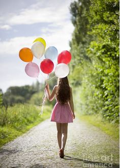 """Beautiful Young Woman With Balloons Greeting Card for Sale by Lee Avison.  Our premium-stock greeting cards are 5"""" x 7"""" in size and can be personalized with a custom message on the inside of the card.  All cards are available for worldwide shipping and include a money-back guarantee."""
