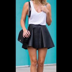 High Waisted Leather Skater Skirt Never worn! This skirt has a zipper on the back. The leather has a reptile print on it. It measures 16 inches long, and right under 13 inches across the waist Skirts Mini