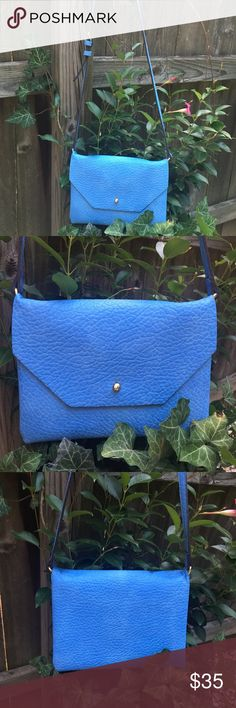 Street Level Blue Leather Cross Body Bag Blue leather, adjustable strap, 3 compartments. Never used...NWOT Street Level Bags Crossbody Bags