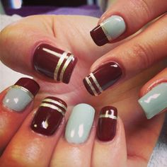 Wine red and grey nails with gold stripes for fall by Karma Salon and Spa!