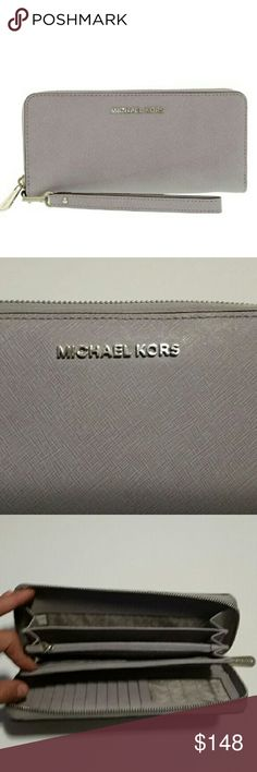"""NWOT MICHAEL Michael Kors JetSet Wristlet Wallet NWOT 100% Authentic Michael Kors Lilac jet set travel continental  Features: Leather, lining: polyester Top zip silver zip closure Interior features 1 zip pocket, 3 accordion style pockets and 10 card slots Comes with wristlet  8-1/4"""" W x 4"""" H x 3/4"""" D MICHAEL Michael Kors Bags Wallets"""