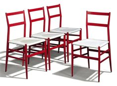 A SET OF FOUR GIO PONTI 'SUPERLEGGERA' CHAIRS PRODUCED BY CASSINA, CIRCA 1960 each with red-lacquered frames, the seats re-strung with nylon cord Each: 32½ in. (82.5 cm.) high (4)