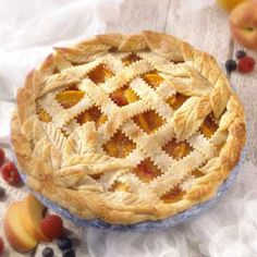Summer's Best Peach Pie: Buy fresh-picked peaches at your farmers' market to make this melt-in your-mouth, double crust pie.