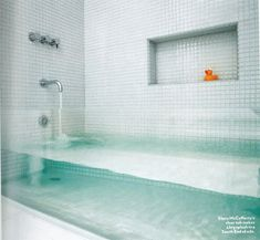 """Invisible"" tub / Made from a thick sheet of glass inserted between the two tile walls http://sulia.com/my_thoughts/5ee2b019-b33f-4fe7-9c78-c513c379cad8/?source=pin&action=share&btn=small&form_factor=desktop&pinner=125502693"