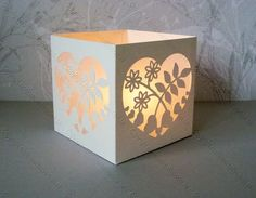 free svg and cut files for this beautiful floral heart votive or tea light holder luminary.