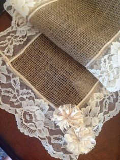 Burlap and Lace Table Runner – beautiful! Love the little lace flowers attached! (could use cut-up old lace curtains to create) – country cute! Jute and lace table runner – beautiful! Love the small lace flowers attached! Burlap Projects, Burlap Crafts, Diy And Crafts, Arts And Crafts, Fabric Crafts, Lace Table Runners, Burlap Table Runners, Lace Runner, Burlap Lace