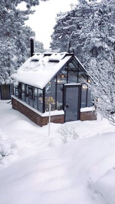 Snow and cold in northern Sweden. Inside the double glass Cape Cod Orangery it is around 20 degrees above zero when the fire is crackling in the stove. www.garden-greenhouse.se