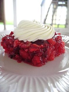 Grandma's Jello - Just like you remember, full of pineapple, cranberries, nuts and Topped with cream cheese, sour cream and sugar mix.