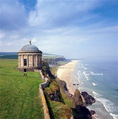 The Mussenden Temple at Downhill, Co Antrim, just getting ready to tumble into the sea. It was a hundred yards further from the cliff's edge when it was built. And it was a library! #temple #antrim #downhill #cliff #castlerock #ireland #library