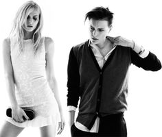 Andrej Pejic in the dress, Erika Linder in the shirt and slacks