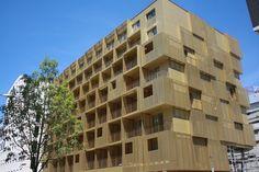 Façade Aluminium perforé anodisé couleur gold 30. Résidence d 'étudiants sur Boulogne. Multi Story Building