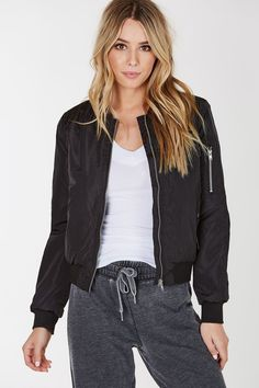 - Ribbed hem - Front zip closure - Light padding - Side pockets - Self: 100% Polyester - Contrast Ribbing: Polyester-Spandex blend - Imported - Model is wearing size S - Runs true to size - Hand wash