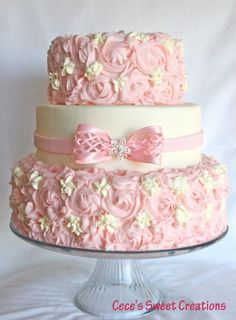 Bridal Shower Wedding Cake - Middle tier is covered in MMF fondant...Tier 1 & 3 are covered in Buttercream rosettes.