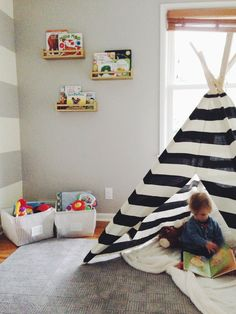 kids room- teepee is a must. IKEA spice racks as book shelves.