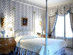 Positively charming, Scandinavian bedroom on the Upper East Side by Clare Fraser. Fraser wrapped the master bedroom in this favorite blue and white print fabric from Country Swedish, and above the bed by hangs a Danish portrait of a lady. The pair of faux painted bedside commodes, originate from Sweden. Gorgeous.