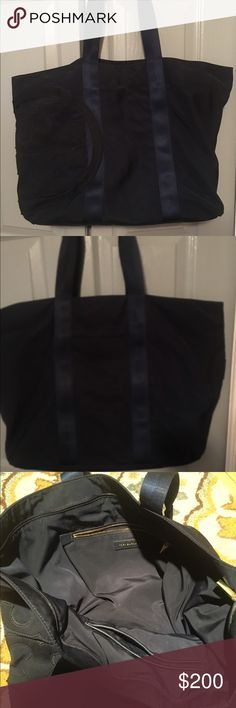 Large Tory Burch Tote Large slouchy nylon navy Tory Burch tote. 1 outside pocket & 3 inside with zip top closure.   Carried handful of times Tory Burch Bags Totes