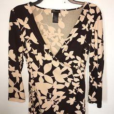 BCBGMaxAzria Printed Dress Size small. Black / tan. Drape cross neckline. Very stretchy. 100% polyester. Leaf like print. Unique & comfy to wear. BCBGMaxAzria Dresses Midi