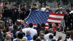 In this Sept. 11, 2013, file photo, the World Trade Center flag is presented as friends and relatives of the victims of the 9-11 terrorist attacks gather at the National September 11 Memorial at the World Trade Center site, for a ceremony marking the 12th anniversary of the attacks in New York