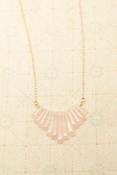 pink quartz art deco necklace Genuine pale pink quartz is cut into graduated lengths to create this up to the minute necklace with an art deco feel. A longer, 24 gold-filled chain makes this fun piece even more versatile. longest stone measures about 2.5 in length. Beautiful!