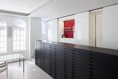 Gorgeous flat files and a pop of color in the home office of creative director Sam Shahid. Design by 1100 Architect. Photo by Michael Moran.