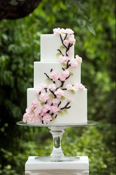 wedding cakes- I like the square three-tier simplicity...