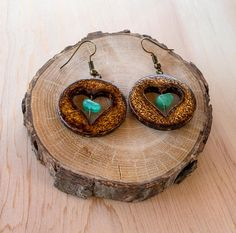This is 100% handmade circle wooden earrings with heart shaped cut-out and Aventurine gemstone. Hardware is in antique bronze color. Wooden body is decorated with freehand pyrography texture, which gives a unique country, rustic feeling to this set. Earring size: 1-1/8 (3 cm) in diameter, hook is 3/4 (2 cm). They are light and comfortable.   This is NOT a photo or laser burn — its a free-hand, one of a kind pyrography item.  * Please note that the colors may vary slightly due to mon...
