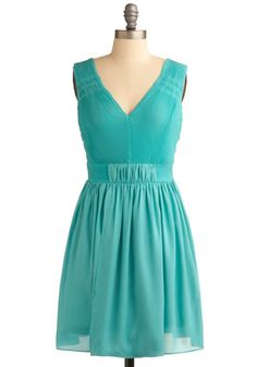 Modcloth Thrilled to Sea You Dress  Dressing in your signature Pisces color of aquamarine, you pair this refreshing, fully lined dress with an engraved locket, a rhinestone-studded bracelet, ribbon-bowed heels, and a simple wristlet as you make plans to meet up again with your newbie buddies!